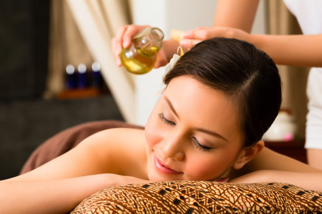 massage with Ylang Ylang Essential Oil