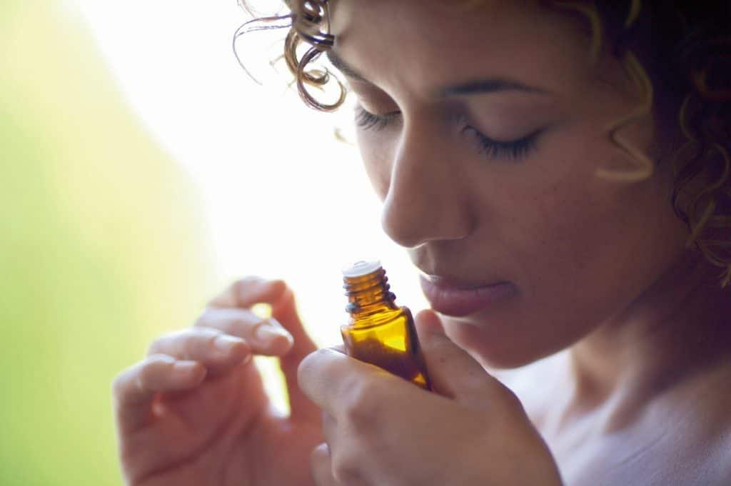 inhaling Ylang Ylang Essential Oil